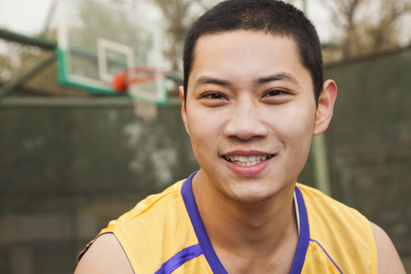 Young man on the basketball court, portrait  photo