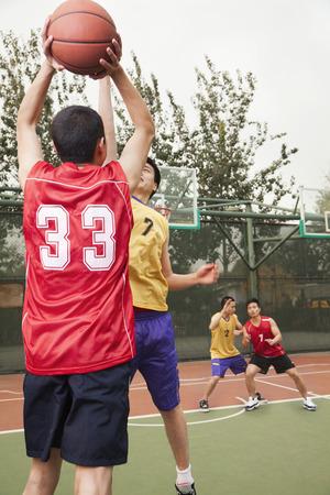 Two teams playing basketball  Stock Photo