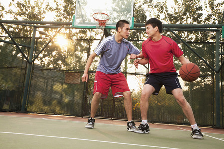 Two street basketball players on the basketball court 写真素材