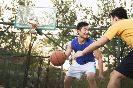 Two street basketball players on the basketball court photo