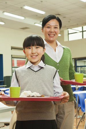 generation gap: Teacher and school girl portrait in school cafeteria