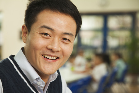 school cafeteria: Teacher portrait at lunch in school cafeteria Stock Photo