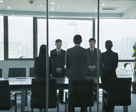 Businesspeople Standing in Conference Room photo