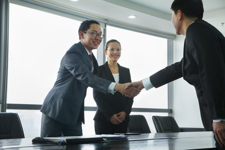 business meeting: Businessmen Greeting Each Other with a Handshake