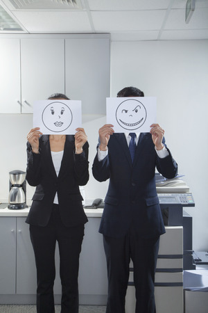 Businesspeople Holding Happy Faces on Paper photo