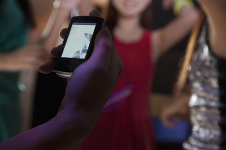 night club series: A young man uses a mobile phone in nightclub