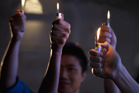 night club series: Group of people holding cigarette lighters at a concert Stock Photo