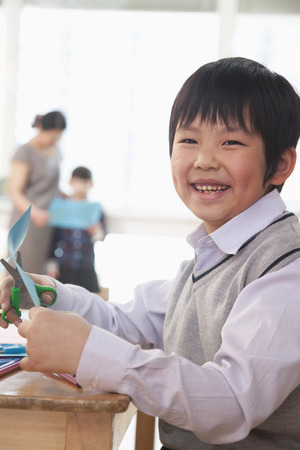some under 18: Portrait of Schoolboy doing arts and crafts, Beijing Stock Photo