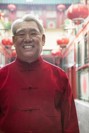 above 30: Portrait of senior man in Chinese traditional clothing Stock Photo