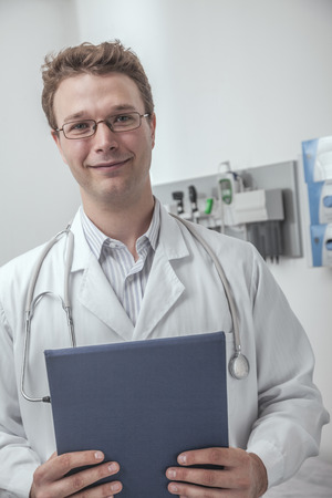 Portrait of smiling doctor holding a clipboard photo