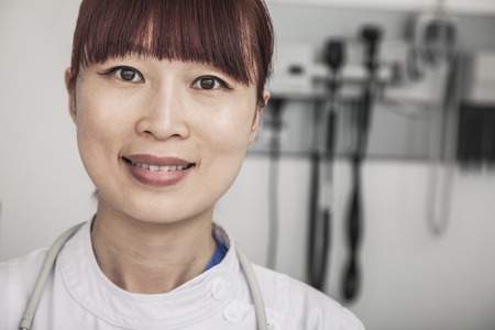 Portrait of smiling female doctor  photo