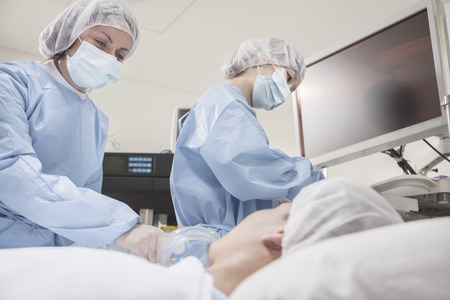 Surgeon consulting a patient, getting ready for surgery
