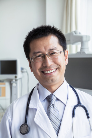 above 30: Portrait of smiling doctor with a stethoscope looking at camera