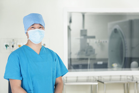 Portrait of young surgeon wearing surgical mask in the operating room photo