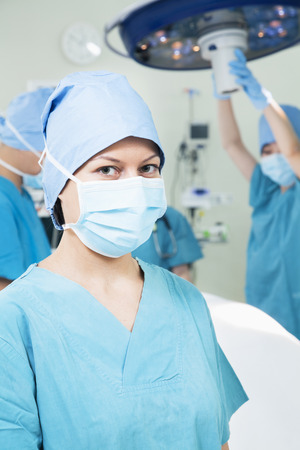 above 18: Portrait of female surgeon wearing surgical mask in the operating room,
