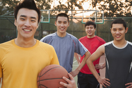 outdoor basketball court: Friends on the basketball court, portrait Stock Photo
