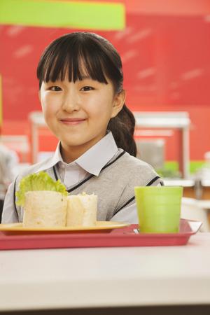 school cafeteria: School girl portrait in school cafeteria