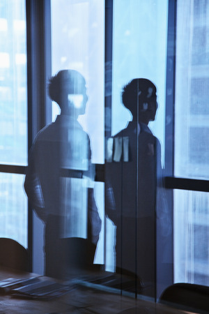 reflection: Reflection of businessman looking outside the window  Stock Photo