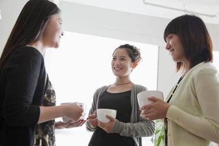 break: Three businesswomen on the coffee break in the office
