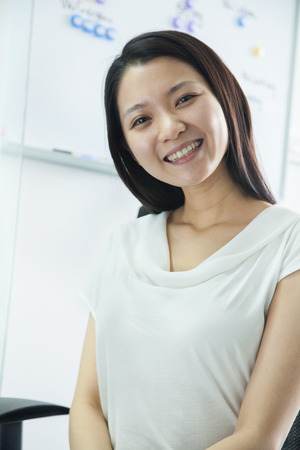 low blouse: Portrait of Young Businesswoman
