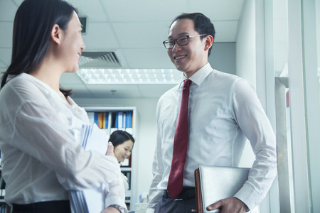 low blouse: Businesspeople Talking at Work