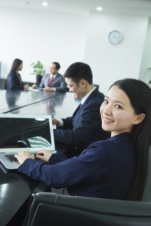 corporate business: Businesswoman Looking Over Her Shoulder at the Camera