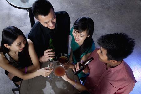 A group of friends having drinks in nightclub