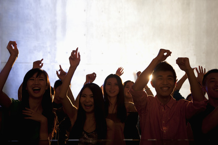 night club series: A crowd of young people dancing in a nightclub