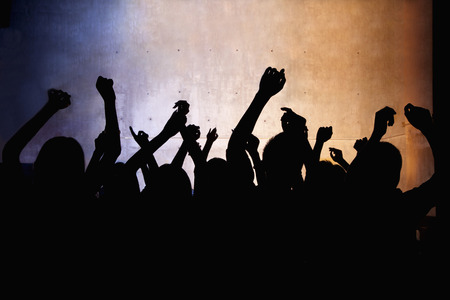 A crowd of young people dancing in a nightclub