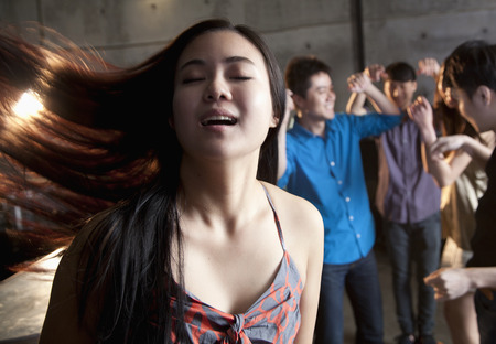 Young woman dancing with her eyes closed photo