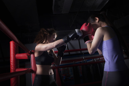above 21: Two female boxers boxing in the boxing ring in Beijing, China