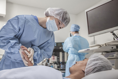 Surgeon consulting a patient, holding hands, getting ready for surgery photo