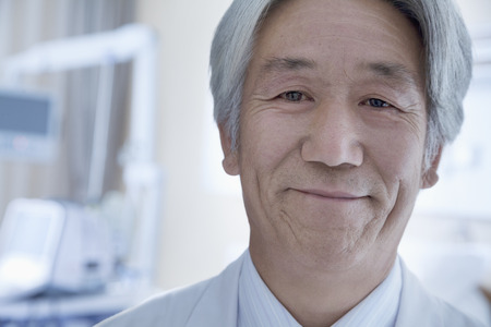 Close-up portrait of mature male doctor in the hospital photo