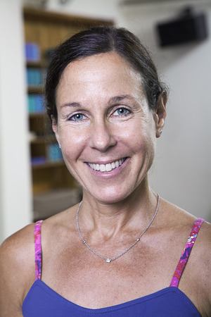 above 30: Portrait of smiling woman in a yoga studio, head and shoulders Stock Photo