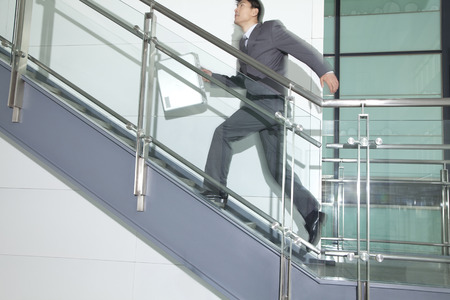steps and staircases: Business Man Running Up Stairs Stock Photo