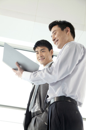 two persons only: Two Businessmen working together Stock Photo