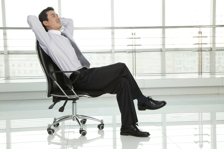 getting away from it all: Businessman Relaxing in Chair