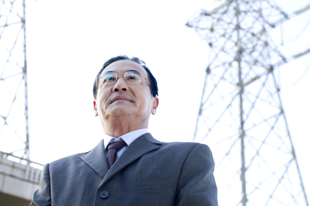 baby boomer: Businessman in Front of Power Lines Stock Photo