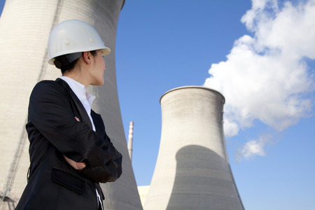 cooling towers: Engineer in front of cooling towers