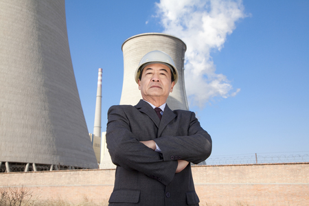 cooling tower: Businessman in front of cooling tower Stock Photo