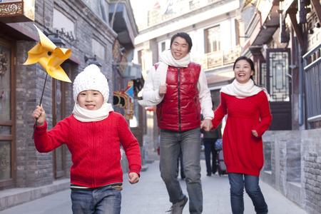 Family having fun in Hutong Stock Photo