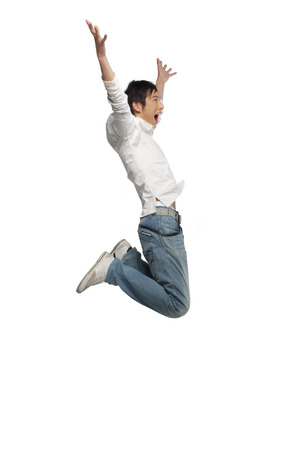 cheer full: Portrait of a young man mid-air