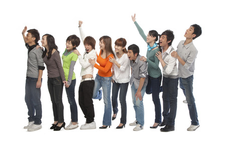 line: A group of young people waiting in line Stock Photo