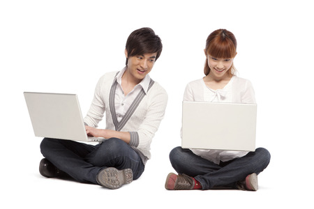 Two friends using laptop computers Stock Photo