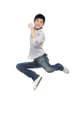full shot: Portrait of a young man mid-air