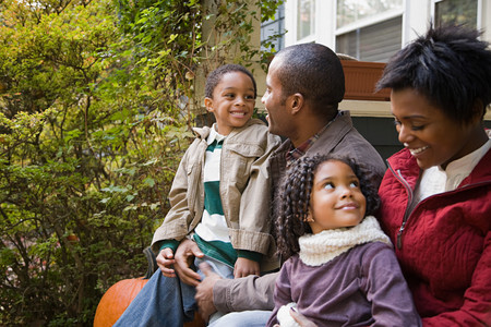 american content: Family in front of house Stock Photo
