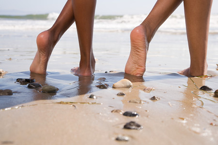 human photography: Two people on beach with crossed legs Stock Photo