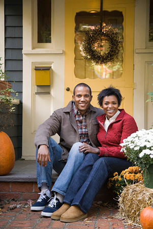 american content: Couple outside house Stock Photo