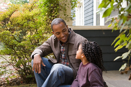 family fall: Father and daughter outside house Stock Photo