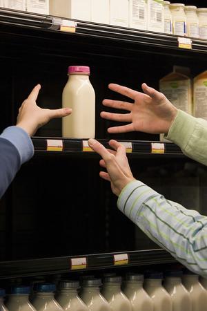 People reaching for milk